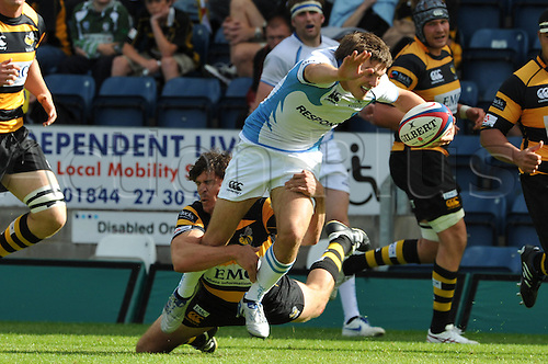 28.08.2010 Ben Jacobs the London Wasps centre in tackling  action during the Rugby Union match from Adams Park Wycombe Buckinghamshire. London Wasps take on Glasgow Warriors in a pre season friendly.