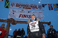 Charlie Bejna at the Nome finish chute Friday March 14 during the 2014 Iditarod Sled Dog Race.<br />