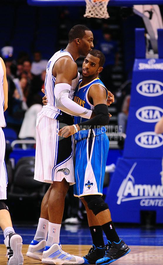 Feb. 11, 2011; Orlando, FL, USA; Orlando Magic center Dwight Howard (12) greets New Orleans Hornets guard (3) Chris Paul at the Amway Center. The Hornets defeated the Magic 99-93. Mandatory Credit: Mark J. Rebilas-