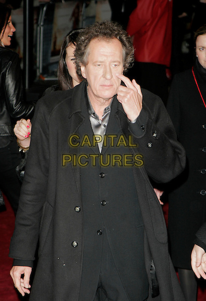 """GEOFFREY RUSH.UK Premiere of """"Elizabeth - The Golden Age"""" at the Odeon Leicester Square, London, England, October 23rd 2007..half length funny  finger itching scratching black coat.CAP/AH.©Adam Houghton/Capital Pictures."""