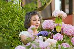 Asian woman working in her garden