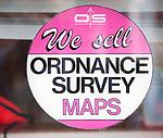 Close up of shop window sign for Ordnance Survey maps, UK