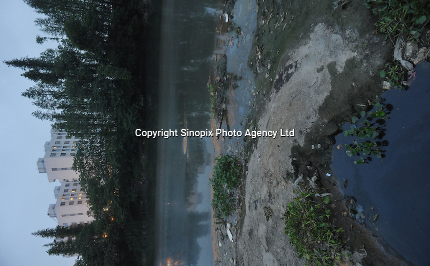 The Osram factory in Foshan, Guangdong Province, China, lies on a heavily polluted tributary of the Pearl River. Osram makes light-bulbs, including energy saving light-bulbs that use mercury as the active component..20 Apr 2009