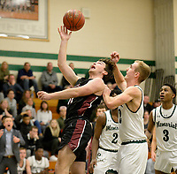 Middleton's Cian Carlson tries to hit a layup in front of Memorial's Logan Younk in the first period, as Middleton takes on Madison Memorial in Wisconsin Big Eight Conference boys basketball on Friday, 12/20/19 at James Madison Memorial High School in Madison