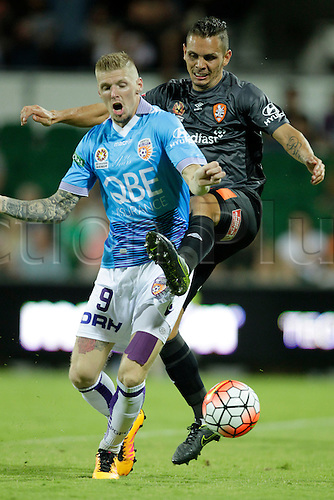 20.02.2016, Perth, Australia. Hyundai A-League, Perth Glory versus Brisbane Roar. Andrew Keogh gets tackled by Jade North during the second half. Perth Glory defeated Brisbane Roar 6-3.