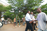 Pedestrians pass a traffic light on Ring Road, Accra
