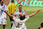 07 December 2014: Los Angeles's Landon Donovan (10), with Marcelo Sarvas (BRA) (above) and Baggio Husidic (6), reacts to the end of the game. Donovan retired after the game. The Los Angeles Galaxy played the New England Revolution in Carson, California in MLS Cup 2014. Los Angeles won 2-1 in overtime.