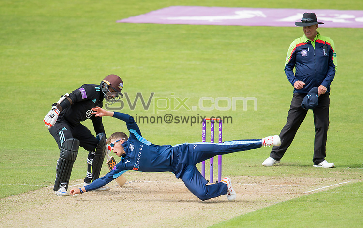 Picture by Allan McKenzie/SWpix.com - 13/06/2017 - Cricket - Royal London One-Day Cup - Yorkshire County Cricket Club v Surrey County Cricket Club - Headingley Cricket Ground, Leeds, England - Yorkshire's Karl Carver makes a diving stop against Surrey.