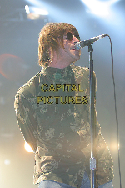 OASIS - LIAM GALLAGHER.Live In Germany.live, concert, stage, singing, camouflage, army, half length, half-length, sunglasses, shades.Ref: F2F.www.capitalpictures.com.sales@capitalpictures.com.© Capital Pictures