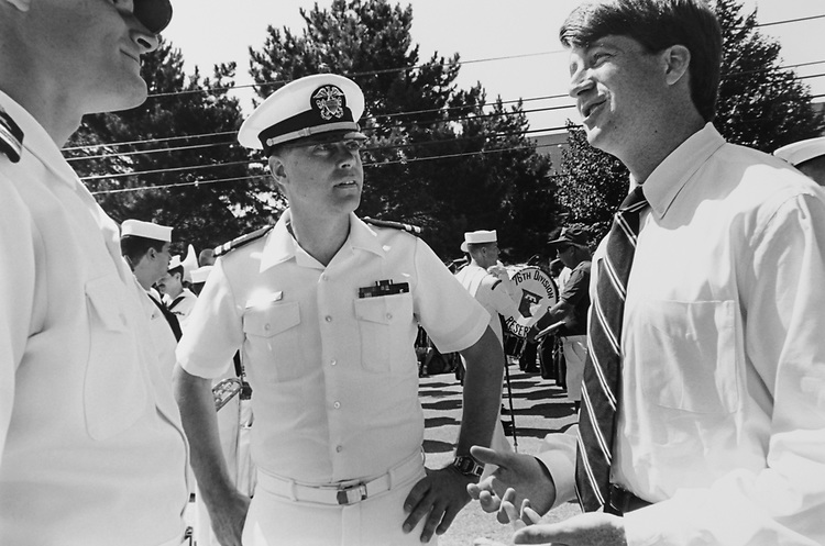 Rep. Patrick J. Kennedy, D-R.I., chats with naval officers prior to the start of the Bristol Parade on July 04, 1994. (Photo by Maureen Keating/CQ Roll Call via Getty Images)