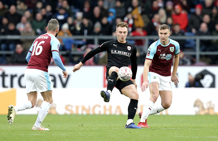 Barnsley's Cauley Woodrow controls under pressure from  Burnley's Steven Defour (left) and Ben Gibson<br /> <br /> Photographer Rich Linley/CameraSport<br /> <br /> Emirates FA Cup Third Round - Burnley v Barnsley - Saturday 5th January 2019 - Turf Moor - Burnley<br />  <br /> World Copyright © 2019 CameraSport. All rights reserved. 43 Linden Ave. Countesthorpe. Leicester. England. LE8 5PG - Tel: +44 (0) 116 277 4147 - admin@camerasport.com - www.camerasport.com