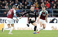 Barnsley's Cauley Woodrow controls under pressure from  Burnley's Steven Defour (left) and Ben Gibson<br /> <br /> Photographer Rich Linley/CameraSport<br /> <br /> Emirates FA Cup Third Round - Burnley v Barnsley - Saturday 5th January 2019 - Turf Moor - Burnley<br />  <br /> World Copyright &copy; 2019 CameraSport. All rights reserved. 43 Linden Ave. Countesthorpe. Leicester. England. LE8 5PG - Tel: +44 (0) 116 277 4147 - admin@camerasport.com - www.camerasport.com