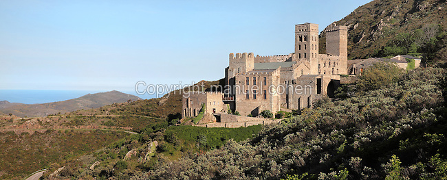 Sant Pere de Rodes, a Benedictine monastery on the Verdera mountain in the Sierra de Rodes, Puerto de la Selva, Girona, Catalonia, Spain. The monastery was founded in 945 by monks who escaped Barbarian invasions with relics of saints, and was eventually sacked in the 17th century and deserted in the 18th century. The Romanesque church was founded in 1022, also notable are the 12th century bell tower and cloisters. Picture by Manuel Cohen