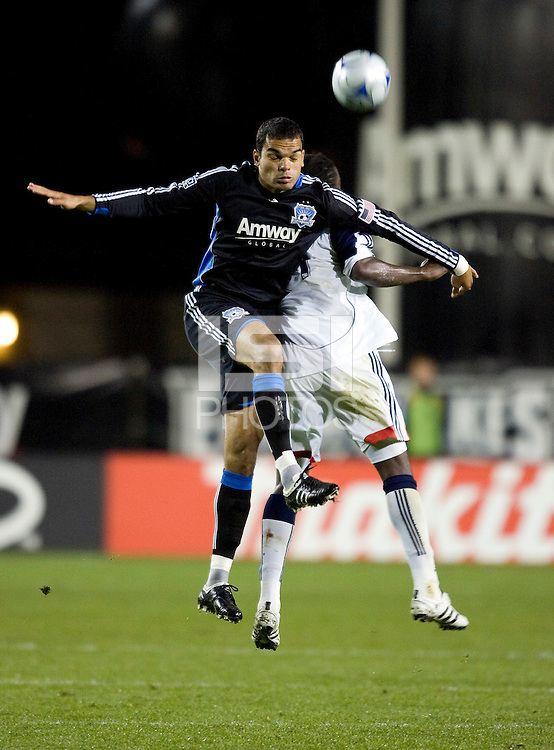 21 March 2009: Pablo Campos of Earthquakes battles for the ball in the air against Shalrie Joseph of Revolution during the game at Buck Shaw Stadium in Santa Clara, California. New England Revolution defeated Earthquakes, 1-0.