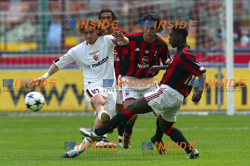Milano 2/5/2004 Campionato Italiano Serie A - Matchday 32<br /> Milan Roma 1-0 <br /> Milan Campione d'Italia - Milan wins italian championship <br /> Francesco Totti (Roma) Alessandro Nesta and Clarence Seedorf (Milan) fight for the ball