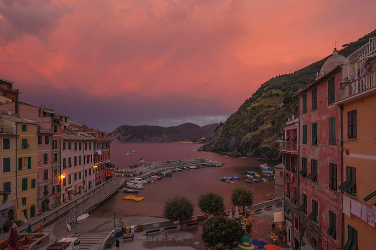 Dramatic dawn light glows over sleepy Vernazza on the Cinque Terre coastline