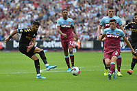Riyad Mahrez of Manchester City shot is blocked by Aaron Cresswell during West Ham United vs Manchester City, Premier League Football at The London Stadium on 10th August 2019