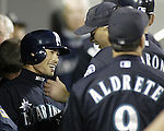 Seattle Mariners Ichiro Suzuki is greeted by teammates in the Mariners dugout after hitting a ball into center field which broke George Sisler's 1920 single season record of 257 in the third inning against the Texas Rangers at Safeco Field on Friday, Oct. 1, 2004 in Seattle. Suzuki has hit 258 so far this season. .Jim Bryant Photo. ©2010. ALL RIGHTS RESERVED.
