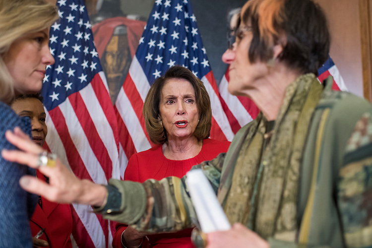 UNITED STATES - DECEMBER 06: Rep. House Minority Leader Nancy Pelosi, D-Calif., center, and Rep. Rosa DeLauro, D-Conn., right, are seen after a news conference in the Capitol with MomsRising and other members on December 6, 2017, to say the Republican tax plan would hurt middle income families by eliminating deductions. (Photo By Tom Williams/CQ Roll Call)