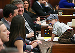Nevada Assemblyman Stephen Silberkraus, R-Henderson, and his wife Chelyn play with their son Sawyer, 22 months, as Republican Rep. Joe Heck speaks to a joint session at the Legislative Building in Carson City, Nev., on Monday, March 30, 2015. <br /> Photo by Cathleen Allison