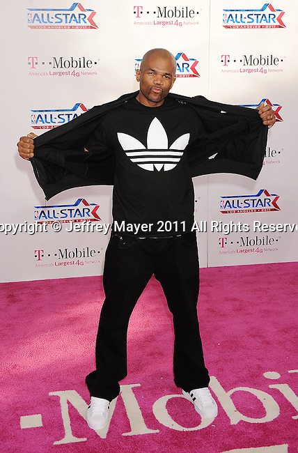 """LOS ANGELES, CA - FEBRUARY 20: Darryl """"DMC"""" McDaniels arrives at the T-Mobile Magenta Carpet at the 2011 NBA All-Star Game at L.A. Live on February 20, 2011 in Los Angeles, California."""