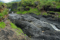 WATERFALLS AND LAVA FLOW OF THE OHE'O GULCH IN HALEAKALA NATIONAL PARK AT KIPAHULU ON MAUI IN HAWAII USA