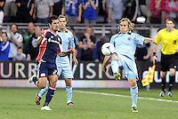 Chance Myers  (7) Sporting KC defender clears the ball... Sporting Kansas City defeated New England Revolution 3-0 at LIVESTRONG Sporting Park, Kansas City, Kansas.