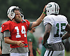 Ryan Fitzpatrick #14, New York Jets starting quarterback, left, chats with teammate #15 Brandon Marshall during team training camp at Atlantic Health Jets Training Center in Florham Park, NJ on Friday, Aug. 5, 2016