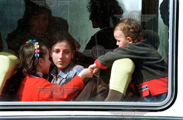 © Andrew Testa / Panos Pictures..KOSOVO. Albanians leave Pristina by coach to Turkey. 24/03/99.