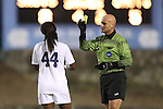 30 November 2013: Referee Robert Sibiga (right) shows the yellow card to North Carolina's Satara Murray (44). The University of North Carolina Tar Heels played the University of California Los Angeles Bruins at Fetzer Field in Chapel Hill, North Carolina in a 2013 NCAA Division I Women's Soccer Tournament Quarterfinal match. UCLA won the game 1-0 in two overtimes.