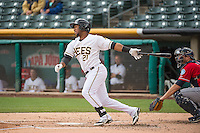 Alfredo Marte (21) of the Salt Lake Bees at bat against the Tacoma Rainiers in Pacific Coast League action at Smith's Ballpark on May 7, 2015 in Salt Lake City, Utah. The Bees defeated the Rainiers 11-4 in the completion of the game that was suspended due to weather on May 6, 2015. (Stephen Smith/Four Seam Images)