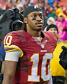 Washington Redskins quarterback Robert Griffin III (10) leaves the field following the game against the Dallas Cowboys at FedEx Field in Landover, Maryland on Sunday, December 28, 2014.  The Cowboys won the game 44-17.<br /> Credit: Ron Sachs / CNP