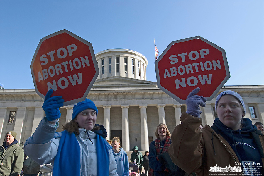 Two women stand with an anti-abortion signs at a Pro-Life rally at the Statehouse in Columbus, Ohio, Monday, Nov. 23, 2006 on the 33rd anniversary of the Supreme Court Roe v. Wade decision.<br />
