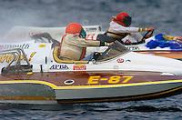 Steve Drucker (E-87) and Jack Cotton pilot their 280 c.i. class Jones hydroplanes through a corner.