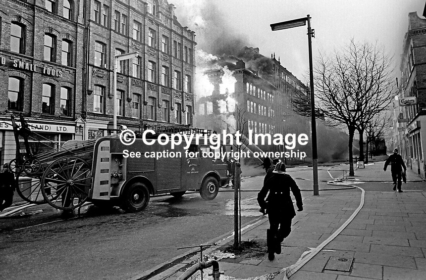 Firemen tackle blaze in Dublin Road, Belfast, N Ireland, following Provisional IRA explosions 6th December 1971. 197112060541a<br /> <br /> Copyright Image from Victor Patterson, 54 Dorchester Park, Belfast, UK, BT9 6RJ<br /> <br /> t1: +44 28 9066 1296<br /> t2: +44 28 9002 2446<br /> m: +44 7802 353836<br /> <br /> e1: victorpatterson@me.com<br /> e2: victorpatterson@gmail.com<br /> <br /> www.victorpatterson.com<br /> <br /> IMPORTANT: Please see my Terms and Conditions of Use at www.victorpatterson.com