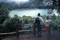 Young couple looking at Laguna Botos in the Parque Nacional Volcan Poas, Costa Rica