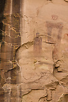 The Sego Canyon pictograph rock art panel in Utah was painted by the people of Archaic Culture in the Barrier Canyon style between 1,500 and 4,000 years ago.  At left is a dark streak of desert varnish on the sandstone.
