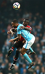 Eric Bailly of Manchester United and Raheem Sterling of Manchester City tangle in the air during the premier league match at the Etihad Stadium, Manchester. Picture date 7th April 2018. Picture credit should read: Simon Bellis/Sportimage