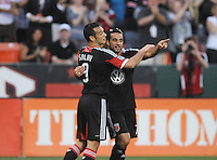 D.C. United forward Dwayne de Rosario (7) celebrates his score in the 25th minute of the game with teammates Hamdi Salihi (9) D.C. United defeated the Colorado Rapids 2-0 at RFK Stadium, Wednesday May 16, 2012.
