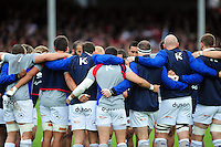 The Bath Rugby players huddle together during the pre-match warm-up. Aviva Premiership match, between Gloucester Rugby and Bath Rugby on October 1, 2016 at Kingsholm Stadium in Gloucester, England. Photo by: Patrick Khachfe / Onside Images