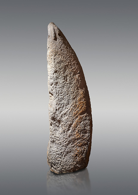 Late European Neolithic prehistoric Menhir standing stone with carvings on its face side. The representation of a stylalised male figure starts at the top with a long nose from which 2 eyebrows arch around the top of the stone. below this is a carving of a falling figure with head at the bottom and 2 curved arms encircling a body above. at the bottom is a carving of a dagger running horizontally across the menhir. Excavated from Perida Iddocca VII site,  Laconi.  Menhir Museum, Museo della Statuaria Prehistorica in Sardegna, Museum of Prehoistoric Sardinian Statues, Palazzo Aymerich, Laconi, Sardinia, Italy. Grey background.