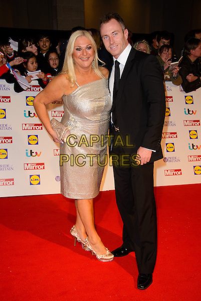 Vanessa Feltz and James Jordan<br /> The Daily Mirror's Pride of Britain Awards arrivals at the Grosvenor House Hotel, London, England.<br /> 7th October 2013<br /> full length dress hand on hip silver  black suit  <br /> CAP/CJ<br /> &copy;Chris Joseph/Capital Pictures