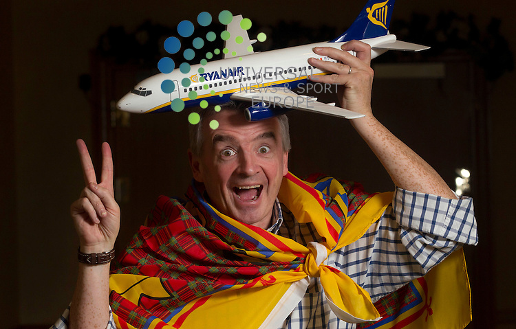 Ryanair's Michael O'Leary as he launches this summer 2013 schedule for Scotland that will help create 400 jobs and help to sustain 3000 jobs at Glasgow and Prestwick Airports. To celebrate 2013 ryanair will have seat sale of 100,00 seats with fares from £18 across the European network..Picture:  Universal News And Sport (Scotland). 4 December 2012 www.unpixs.com.