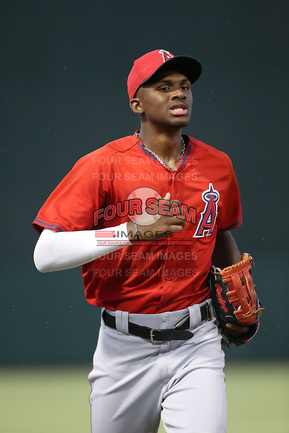 Jimmy Barnes (17) of the AZL Angels returns to the dugout during a game against the AZL Giants at Tempe Diablo Stadium on July 6, 2015 in Tempe, Arizona. Angels defeated the Giants, 3-1. (Larry Goren/Four Seam Images)