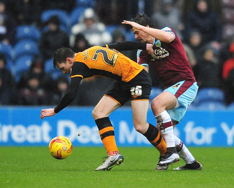 Hull City's Andrew Robertson is fouled by Burnley&rsquo;s Joey Barton<br /> <br /> Photographer Chris Vaughan/CameraSport<br /> <br /> Football - The Football League Sky Bet Championship - Burnley v Hull City - Saturday 6th February 2016 - Turf Moor - Burnley <br /> <br /> &copy; CameraSport - 43 Linden Ave. Countesthorpe. Leicester. England. LE8 5PG - Tel: +44 (0) 116 277 4147 - admin@camerasport.com - www.camerasport.com
