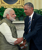 United States President Barack Obama shakes hands with Prime Minister Narendra Modi of India in the Oval Office of the White House in Washington, DC on June 7, 2016.  During their meeting the leaders discussed a number of topics including cybersecurity, climate change, and economic cooperation.<br /> Credit: Dennis Brack / Pool via CNP