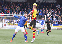 Sean McGinty heading the ball to beat Stephen Dobbie in the SPFL Ladbrokes Championship football match between Queen of the South and Partick Thistle at Palmerston Park, Dumfries on  4.5.19.