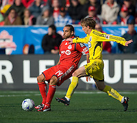 02 May 2009: Toronto FC midfielder Dewayne DeRosario #14 and Columbus Crew midfielder Brian Carroll #16 in action at BMO Field in a game between the Columbus Crew and Toronto FC. .The game ended in a 1-1 draw...