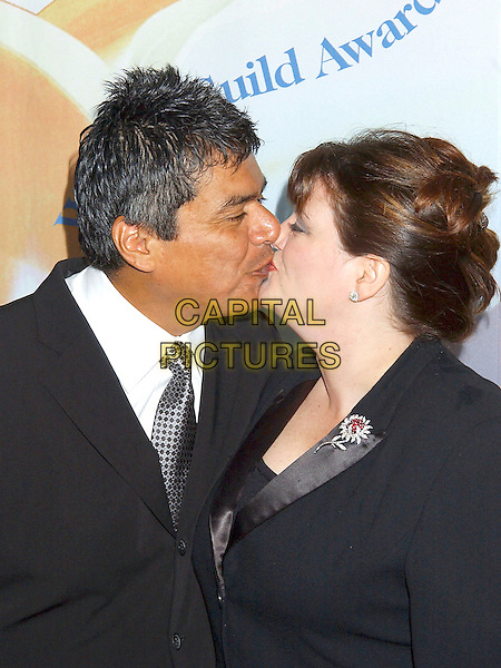GEORGE LOPEZ & WIFE ANN.57th Annual Writers Guild Awards held at the Hollywood Palladium, Hollywood, California, USA,.19th February 2005  .portrait headshot kissing.Ref: ADM.www.capitalpictures.com.sales@capitalpictures.com.©Laura Farr/AdMedia/Capital Pictures