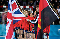 23 NOV 2011 - LONDON, GBR - British players, including Lyn Byl (with short hair by flag staff), Kelsi Fairbrother (with red hair) and Louise Jukes (on her left), sing the British National Anthem before the start of their opening match at the 2011 London Handball Cup against Angola at The Handball Arena in the Olympic Park in Stratford, London (PHOTO (C) NIGEL FARROW)